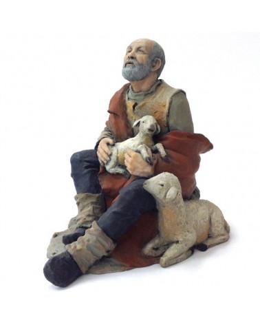 Shepherd sitting and sheet