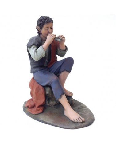 Hirte beim Flöte spielen