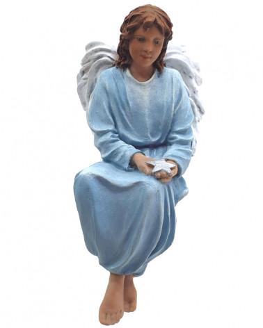 Angel assegut amb una...