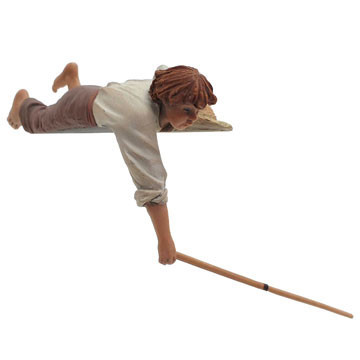 Child lying with a stick 15cm.
